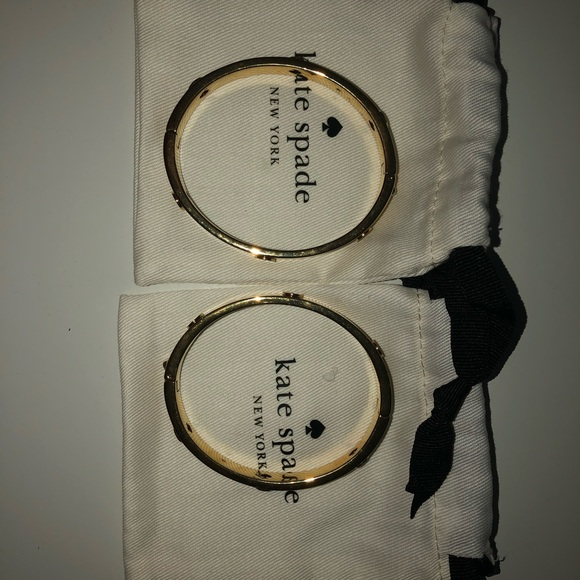 Kate spade gold bracelets with logo all around